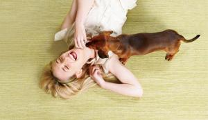 woman-laughing-floor-dog-628X363-COMP-PV0214