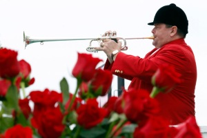 Steve Buttleman, the official bugler at Churchill Downs since 1995, blows the call to post for a first race ahead of the 137th running of the Kentucky Derby.