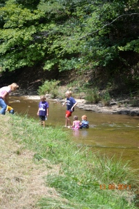 KIDS PLAYING IN THE CREEK